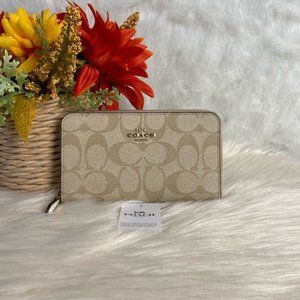 COACH MEDIUM ZIP AROUND WALLET IN SIGNATURE CANVAS